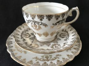Gladstone china white and gilt lace triio